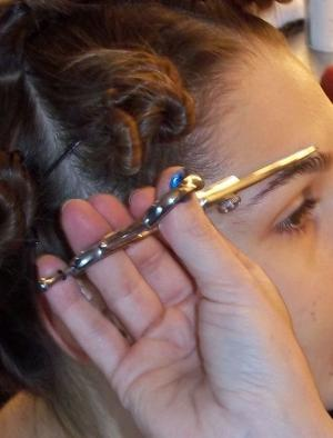 Shape_and_trim_brows_using_Tweezerman_tweezers._
