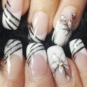 French_manicure_with_silver_tropical_flowers_