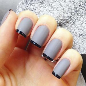French_manicure_with_gray_nail_bed_and_black_tips_