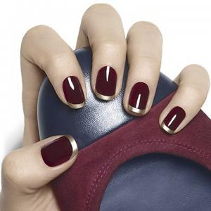 French_manicure_in_marsala_with_gilded_tips_