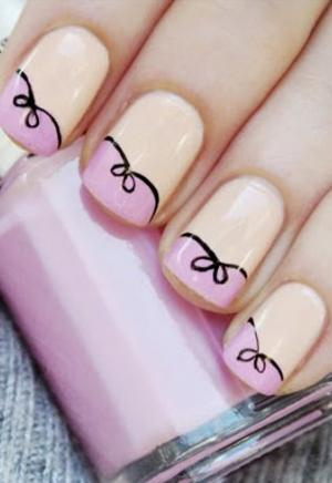 French_manicure_in_pink_with_black_bows_