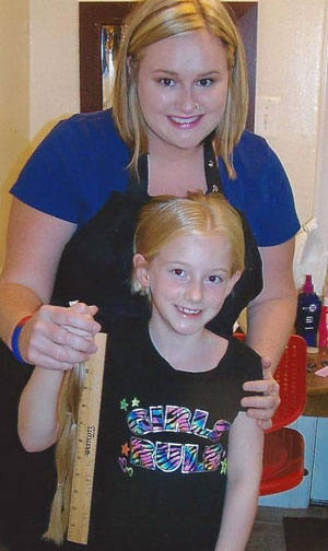 Child donors such as Gretta contribute to the Wigs for Kids charity.