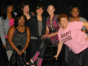 Jen and a group of women support the Boston Broads Breast Cancer Comedy Benefit, which was hosted by comedian, Nooch (at far right, in pink).