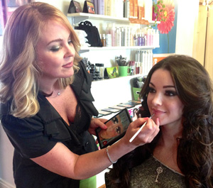 Sherri Jessee works her beauty magic on TV personality Lauren Barnette, who was also Miss Virginia USA 2007.