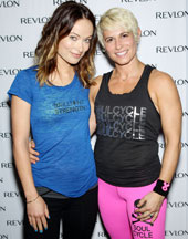 From left: Revlon Brand Ambassador Olivia Wilde smiles alongside SoulCycle instructor Melanie Griffith.