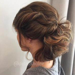 Lobs_-_Updos_and_Braids__Faux_updos_that_pass_for_the_real_thing_are_possible_with_a_shoulder-grazing_lob._Chignons_with_twists_and_curls_to_connect_the_sides_can_also_make_an_on-trend_fashion_statement._Stylist:_Detra_Smith_IG_@detrashaleeTip:_For_best_results_with_any_updo,_curl_the_hair_from_roots_to_ends._Lightly_brush_out_the_curls_and_tease_the_base_to_create_fullness_at_the_scalp._