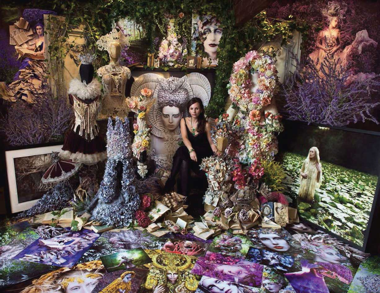 Kirsty Mitchell surrounded by her Wonderland props, pictures and costumes