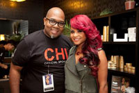 Arthuro Gray poses alongside Christina Milian.