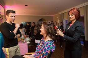 Experts style the locks of guests, creating chic looks for the evening`s fun, fashionable festivities