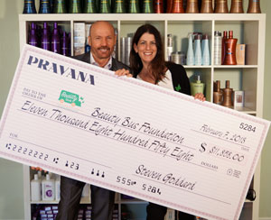 PRAVANA presents a check to Beauty Bus Foundation in support of Breast Cancer Awareness month 2012.