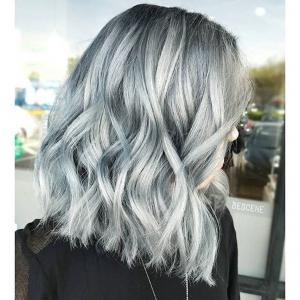 Textured_Lobs__Textured_lobs_look_fabulous_on_a_variety_of_cuts._Shown:_an_urban-chic,_one-length_lob_that_has_been_loosely_curled_with_the_ends_left_straight._The_textured_element_has_been_accomplished_with_a_texture_product_and_finger_styling._Stylist:_Linh_Phan_@bescene__Tip:_Multidimensional_hair_color_designs_that_run_throughout_the_hair_draw_attention_to_texture_and_movement,_whether_the_lob_is_layered,_one-length,_straight_or_curly._