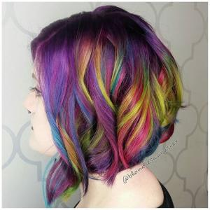 Textured_Lobs__Topped_with_a_bold_color_design,_this_beautiful_haircut_is_bob_length_in_back_and_lob_length_in_front._We_love_how_the_curly_texture_has_been_strategically_styled_in_opposing_directions_to_create_a_drool-worthy_style._Stylist:_Michelle_Saunders_@blondiesaurusrex__Tip:_For_longer_pieces_around_the_front_hairline,_curling_the_hair_away_from_the_face_(with_the_exception_of_the_bottom_layer)_creates_a_signature_lob_style._