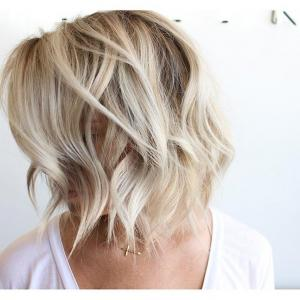 Layered_Lobs__Textured_ends_and_a_messy_style_create_a_casually_tossed_lob_that_works_well_for_the_office_and_a_cozy_dinner_for_two._Stylist:_Charlie_Price_IG_@hairbycharlie__Tip:_For_fine,_thin_hair,_a_darker_hair_color_base_gives_the_illusion_of_thicker,_more_substantial_hair._