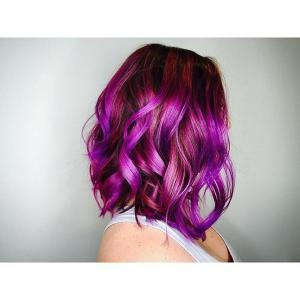 Textured_Lobs__Flat_ribbon_curls_and_a_gorgeous_multidimensional_hair_color_design_emphasize_texture_and_movement._Is_this_color_too_bright_for_your_clients?_Envision_this_style_with_an_ombre_application_that_melts_from_light_brunette_to_blonde._Stylist:_Cody_IG_@codester_arcs__Tip:_Lobs_with_controlled_movement_can_be_given_a_messy_change-up_by_using_a_light_styling_spray,_slipping_your_fingers_onto_the_base_of_the_hair_and_giving_it_a_quick_shake._