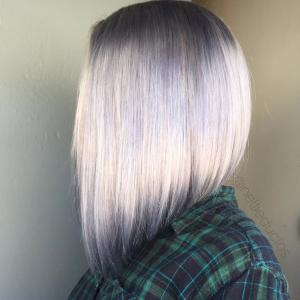 Straight_Smooth_Lobs__Featuring_an_extreme_A-line_(longer_in_front)_perimeter_shape,_this_classic,_all-one-length_lob_haircut_is_accentuated_with_a_smoky_purple_shadow_root._Stylist:_Nellie_Duclos_IG_@nellieduclos__Tip:_When_styling_a_smooth,_straight_bob,_it's_essential_to_carefully_blow-dry_the_hair_using_moderate_tension_and_always_pointing_your_blow_dryer_toward_the_ends_of_the_hair._