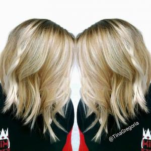 Textured_Lobs__This_classic_lob_can_be_blown_straight_or_styled_for_added_texture._Either_way,_the_A-line_perimeter_(longer_in_front)_is_the_epitome_of_a_modern,_on-trend_shape._Stylist:_Tina_Gregoria_IG_@tinag.hairwhisperer__Tip:_By_applying_a_light_amount_of_paste_or_pomade_to_loose_curls_and_straight_ends,_texture_becomes_the_focal_point_of_your_client's_style._