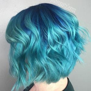 Layered_Lobs__Blue_shadow_root_and_sparkling_aqua_blue_hair_color_accentuate_the_details_of_this_layered_lob_that_has_shorter_layers_along_the_back_and_sides_for_added_fullness_and_texture._Stylist:_Vanessa_Fermin_IG_@vanessastylesyou__Tip:_Layered_lobs_can_create_fullness_on_the_sides_of_the_head_to_visually_widen_a_long,_narrow_face_shape._